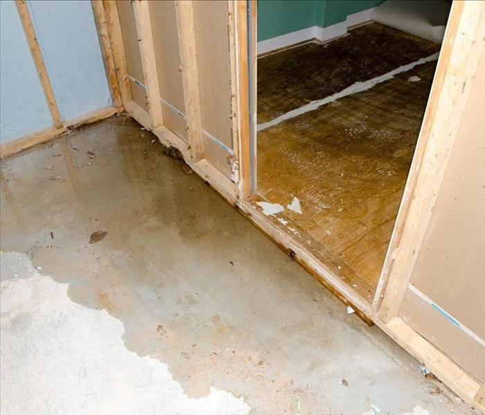 Water damage in two rooms with the flooring taken up