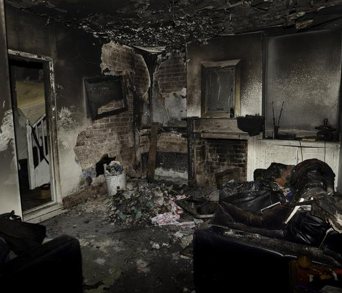 Fire and soot damage in a living room.